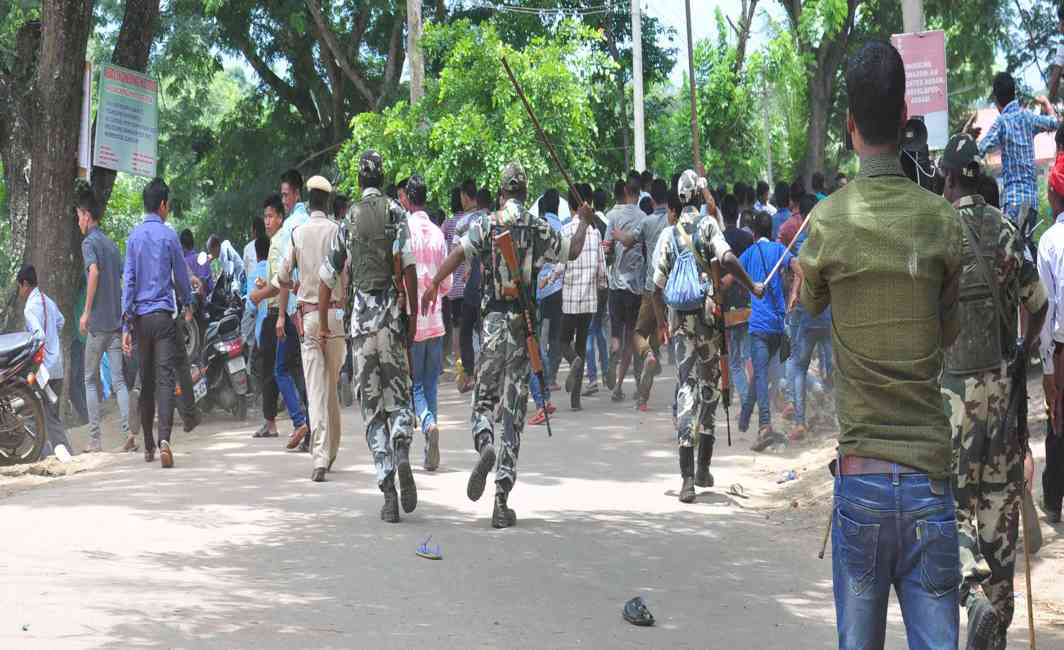 CROWD CONTROL: Security forces resort to lathicharge on the public outside a polling station during the Karbi Autonomous Council election, in Diphu, UNI