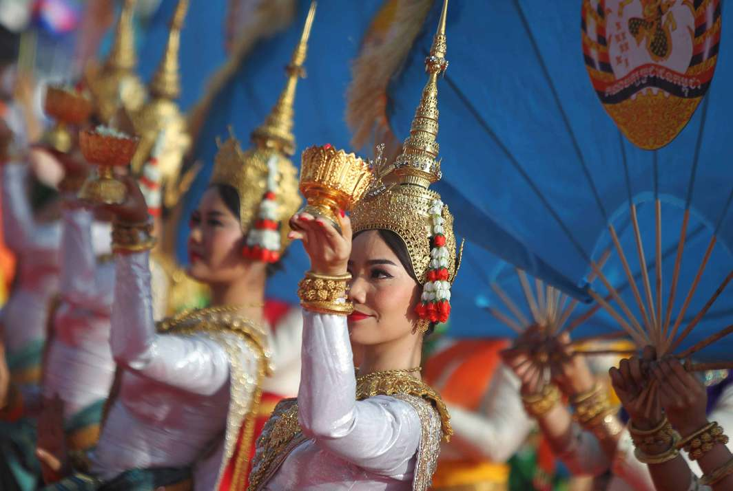 BEAUTIFUL PEOPLE: Dancers perform during a ceremony to mark the 66th anniversary of the establishment of the Cambodia People Party, at Koh Pich island in Phnom Penh, Cambodia, Reuters/UNI