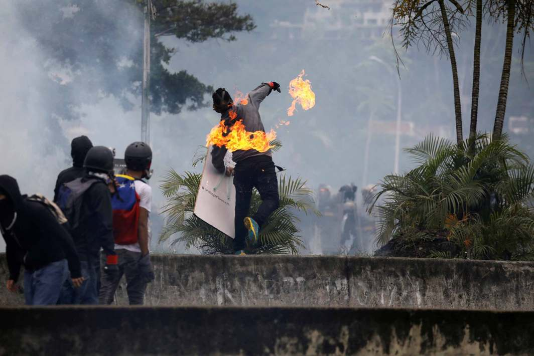 LIVING THE RISING: Demonstrators clash with riot security forces while rallying against Venezuela's President Nicolas Maduro's government in Caracas, Venezuela, Reuters/UNI