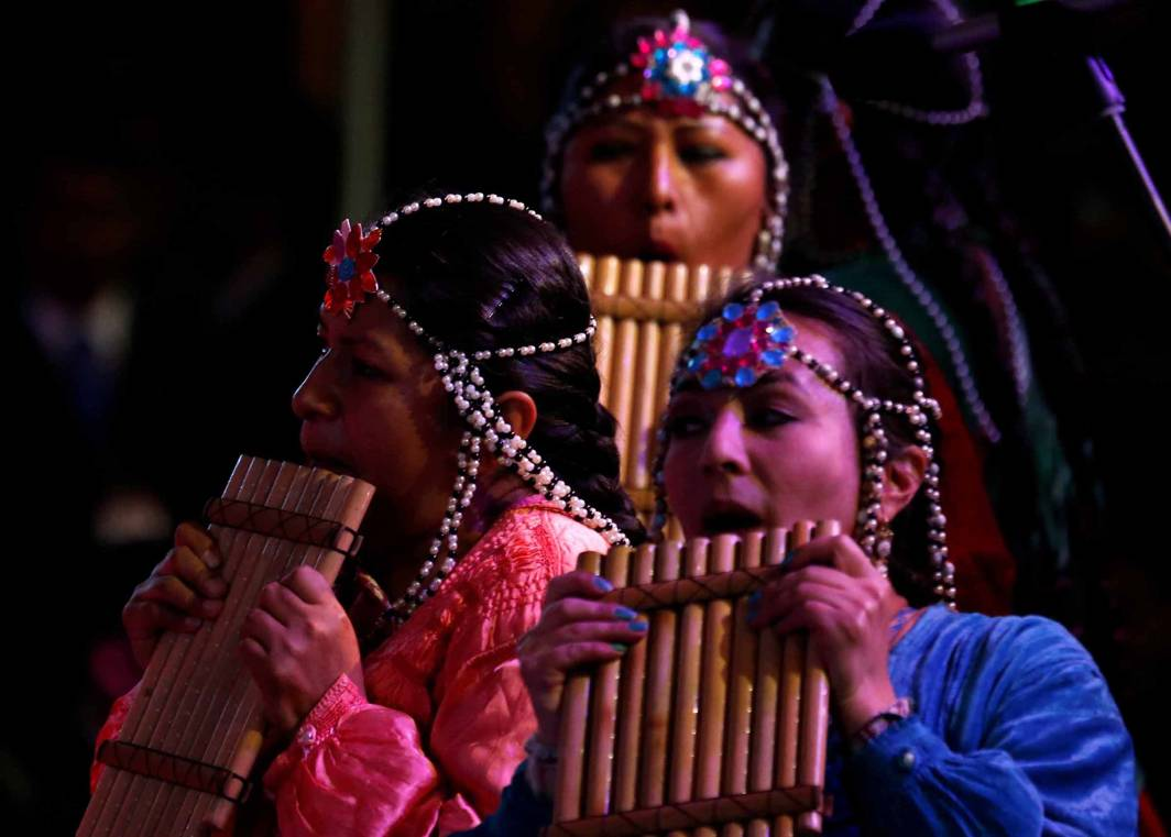 NOTES FROM THE SOUL: A Bolivian troupe performs on the pan flute at the closing ceremony of World People Conference in Tiquipaya, Cochabamba, Bolivia, Reuters/UNI