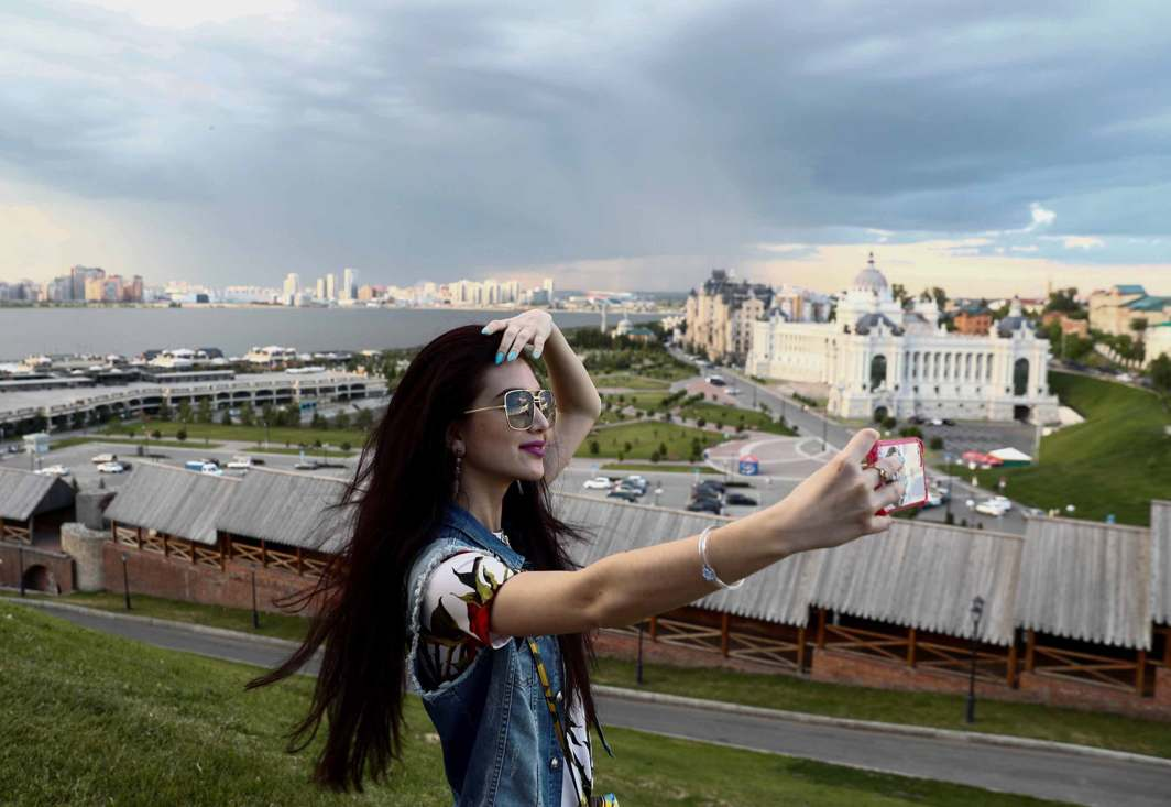 BEEN THERE: A woman takes a selfie at the Kremlin of Kazan ahead of the FIFA Confederations Cup Russia 2017, Reuters/UNI