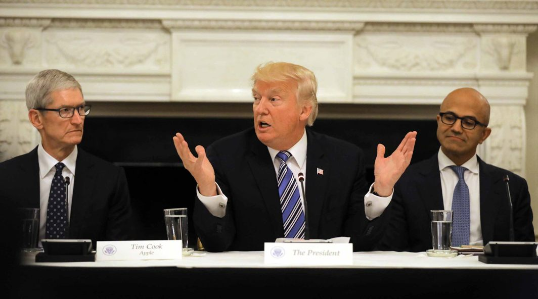 TECHING THE CALL: US President Donald Trump participates in an American Technology Council roundtable, accompanied by Tim Cook, CEO of Apple (left), and Satya Nadella, CEO of Microsoft Corporation, at the White House in Washington, Reuters/UNI