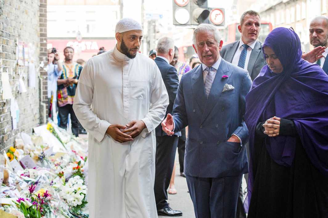 MESSAGE OF HUMANITY: Britain's Prince Charles visits the tributes left at the scene of the Finsbury Mosque attack alongside Imam Mohammed Mahmoud, who protected the attacker after the incident, Reuters/UNI