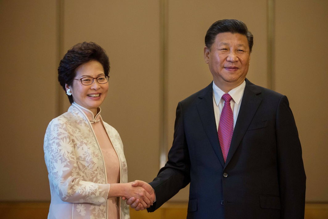 TOGETHER NOW: China's President Xi Jinping shakes hands with Hong Kong's Incoming Chief Executive Carrie Lam ahead of a meeting in Hong Kong, Reuters/UNI