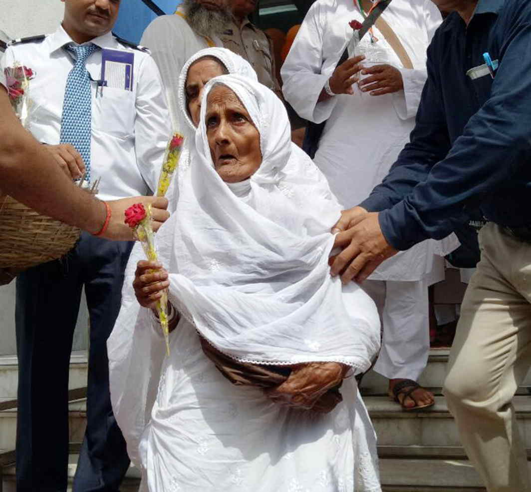 LONG ROAD AHEAD: The first batch of Haj pilgrims leaves Haj House in Lucknow, UNI