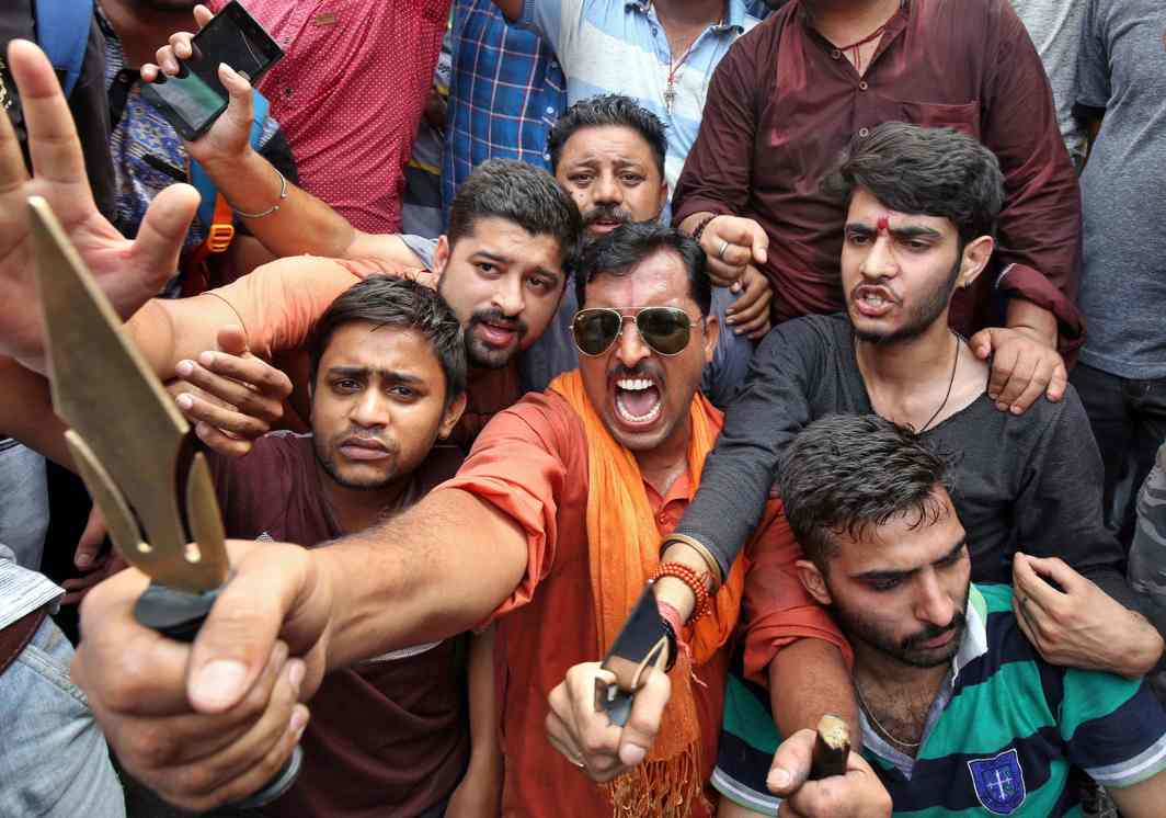 UNAVOIDABLE HOSTILITY: People react as they hold tridents and shout slogans during a protest organised by Hindu nationalist group Vishva Hindu Parishad against Pakistan after seven Amarnath Yatra pilgrims were killed by militants in Kashmir, UNI