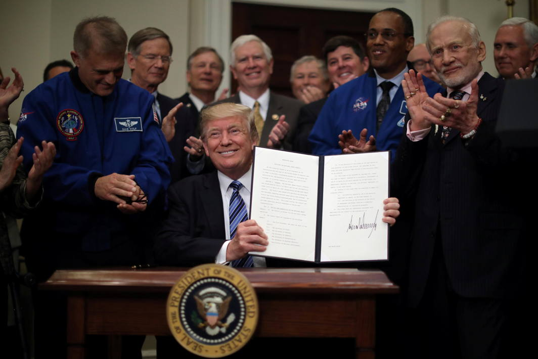 SPACE COWBOY: US President Donald Trump signs an executive order to create the National Space Council, accompanied by former astronauts Buzz Aldrin (2nd-R), Alvin Drew (3rd-R) and Dave Wolf (L) in the Roosevelt room of the White House, in Washington, DC, Reuters/UNI