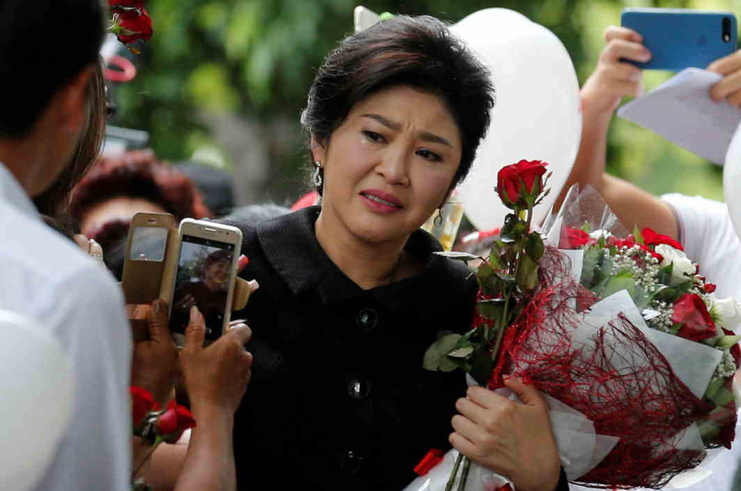 SOLICITING SUPPORT: Ousted former Thai prime minister Yingluck Shinawatra greets supporters as she arrives at the Supreme Court in Bangkok, Reuters/UNI
