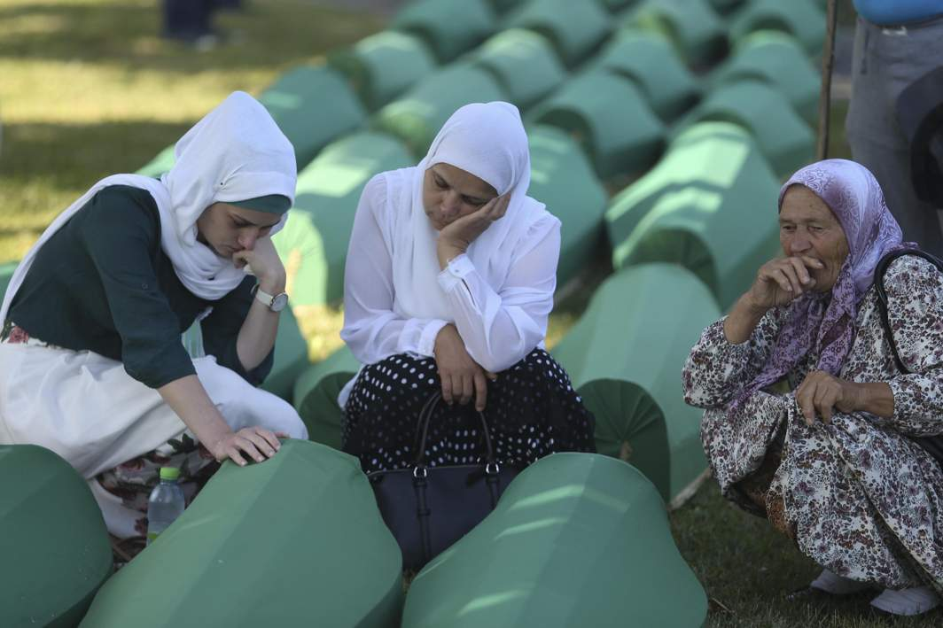 MEMORIES OF MIDNIGHT: Women cry near coffins of their relatives, who were newly identified as victims of the 1995 Srebrenica massacre, lined up for a joint burial in Potocari near Srebrenica, Bosnia and Herzegovina, Reuters/UNI