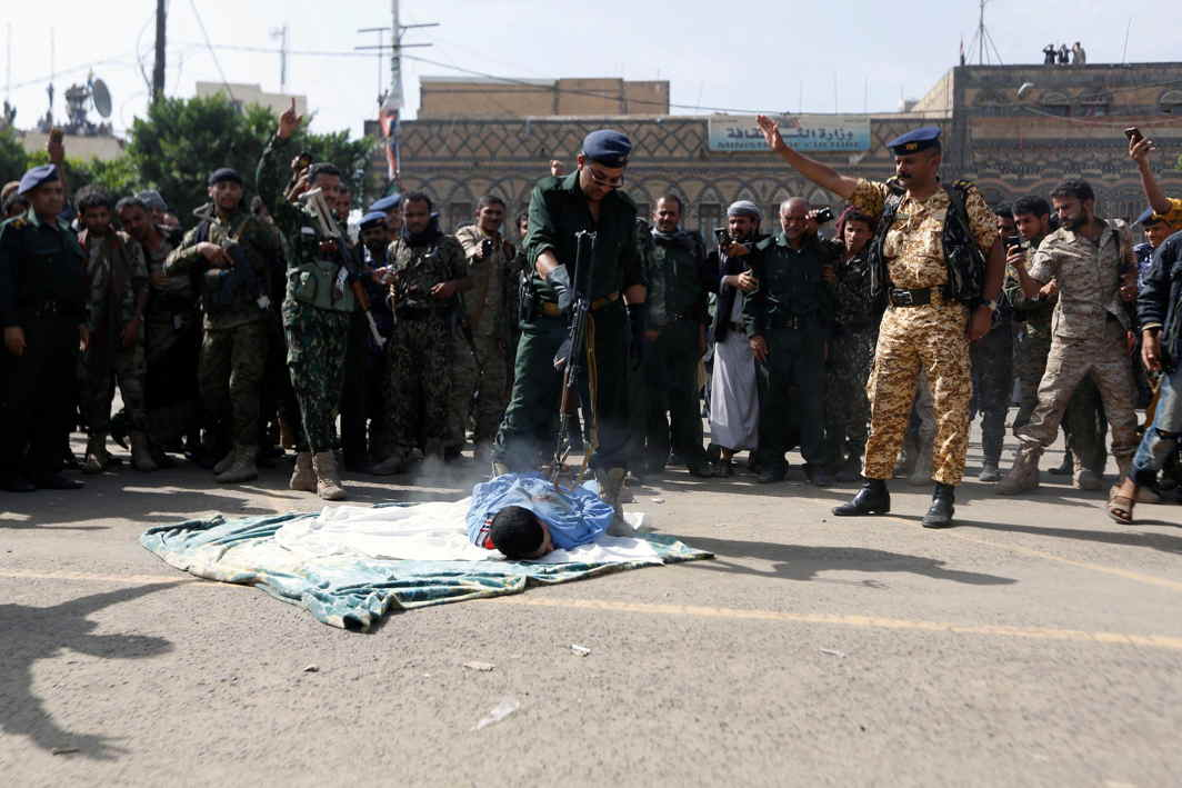 COMEUPPANCE: A police officer opens fire at Muhammad al-Maghrabi, 41, who was convicted of raping and murdering a three-year-old girl, in Sanaa, Yemen, Reuters/UNI