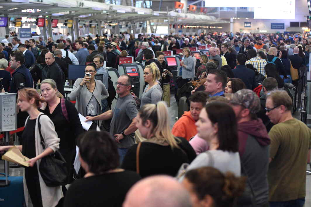 IN LIMBO: Passengers queue up at Sydney's Domestic Airport. Fliers are being subjected to increased security measures in the wake police raids associated with a plot against Australia's aviation sector, AAP/Dean Lewins/Reuters/UNI