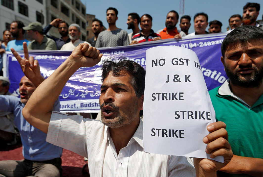 THREATENED: Traders shout slogans during a strike to protest against implementation of the Goods and Services Tax (GST) in Jammu and Kashmir state, in Srinagar, Reuters/UNI