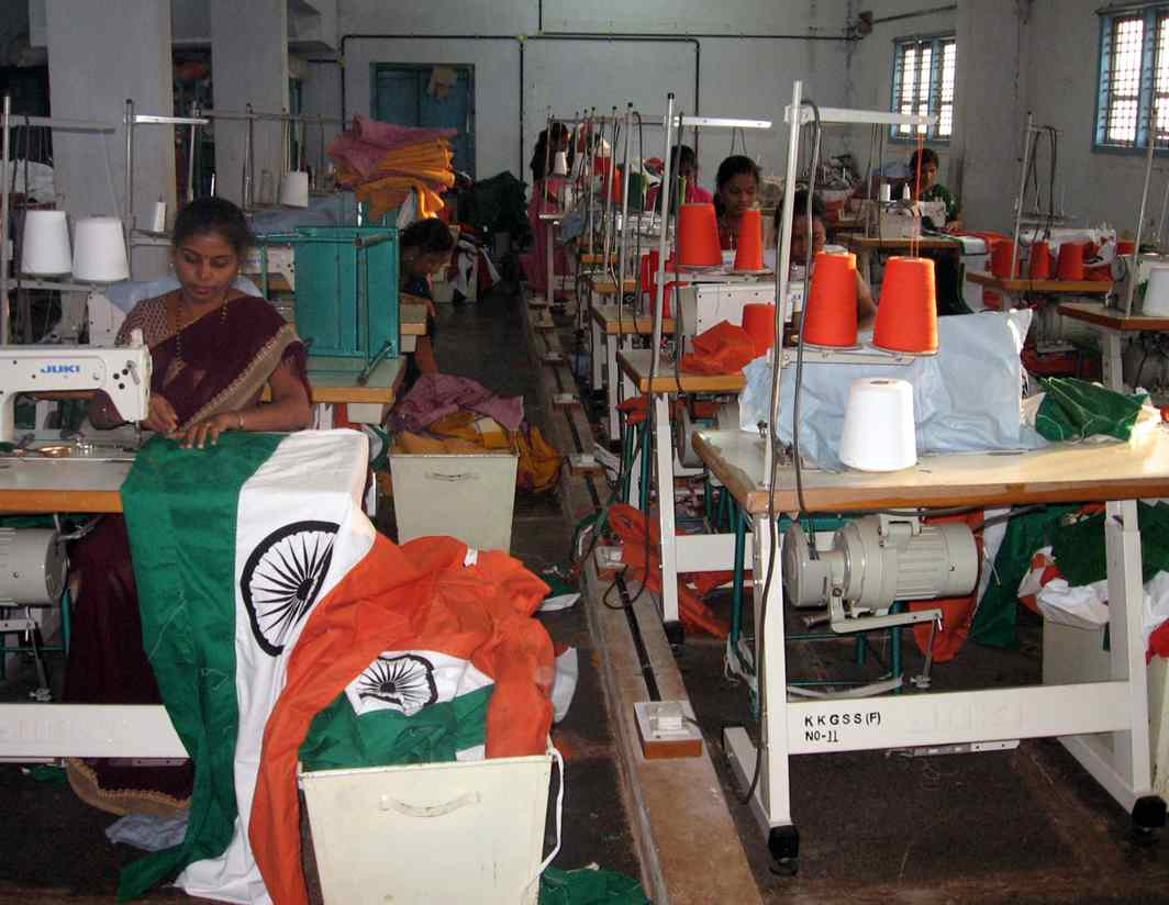 ANOTHER DAY IN PARADISE: Workers stitch national flags ahead of Independece Day, at a production unit of Karnataka Khadi and Gramodyog Samyukta Sangh in Hubbali, UNI