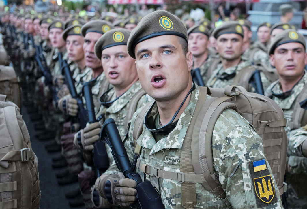 COUNT LIKE SOLDIERS: Ukrainian servicemen stand in line during a rehearsal for the Independence Day military parade in central Kiev, Ukraine, Reuters/UNI