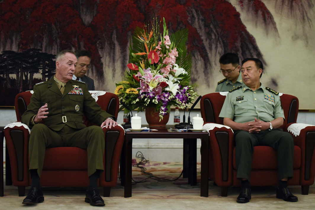 WHAT'S ON THE AGENDA? Chairman of the US Joint Chiefs of Staff, General Joseph Dunford (L) meets Chinese vice-chairman of the Central Military Commission Fan Changlong (R) in Beijing, Reuters/UNI