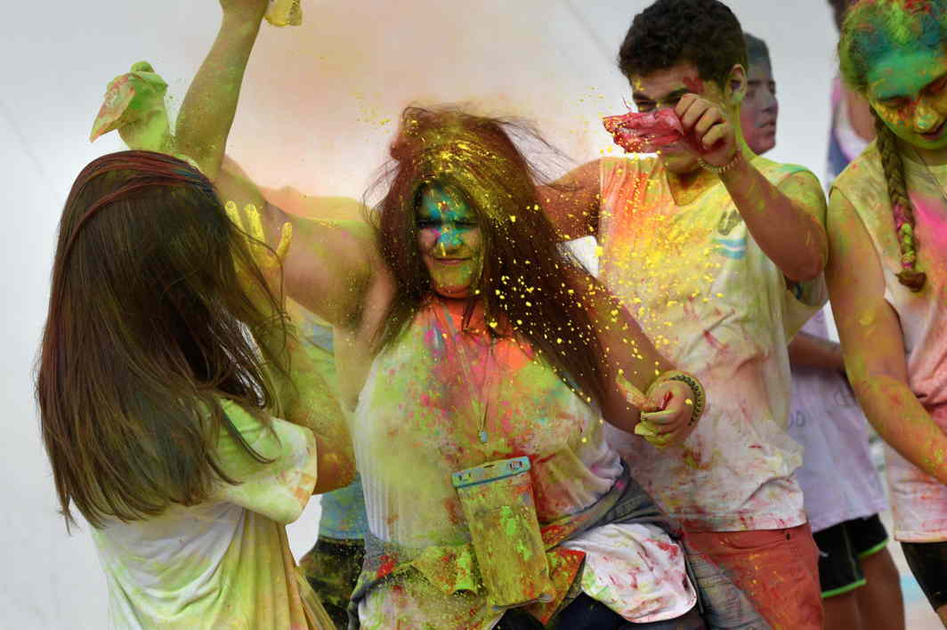 CULTURAL APPROPRIATION? Revellers take part in the Holi Party Festival at the Niemeyer Center in Aviles, northern Spain, Reuters/UNI