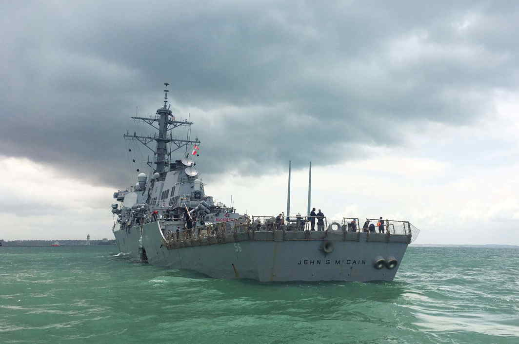 THE GREEN SEA: US Navy guided-missile destroyer USS John S McCain is seen after a collision, in Singapore waters, Reuters/UNI