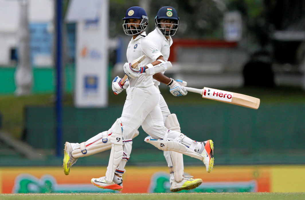 SOLID TOTAL: Ajinkya Rahane and Ravichandran Ashwin run between wickets during the second Test match between Sri Lanka and India in Colombo, Reuters/UNI