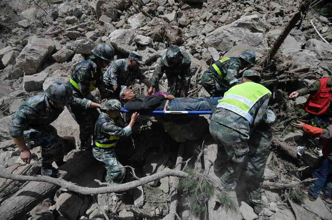 WHEN DISASTER STRIKES: Chinese paramilitary police carry a survivor after an earthquake in Jiuzhaigou county, Ngawa prefecture, Sichuan province, China, Reuters/UNI