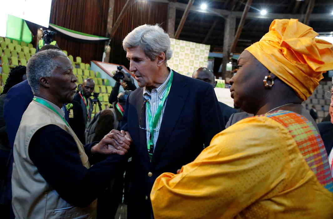 ON SPECIAL DUTY: Former US Secretary of State John Kerry and former South Africa President Thabo Mbeki, observers for the general election in Kenya, greet each other next to former Senegalese Prime Minister Aminata Toure in a tally centre in Nairobi, Kenya, Reuters/UNI