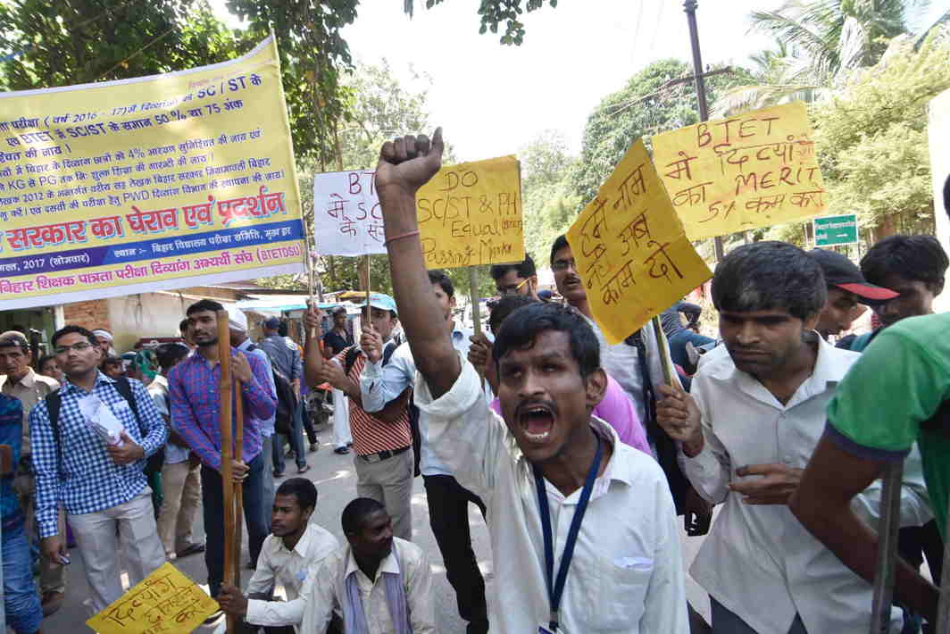 EQUITY MEANS JUSTICE: Disabled students stage a demonstration outside Bihar School Examination Board to press their various demands in Patna, UNI