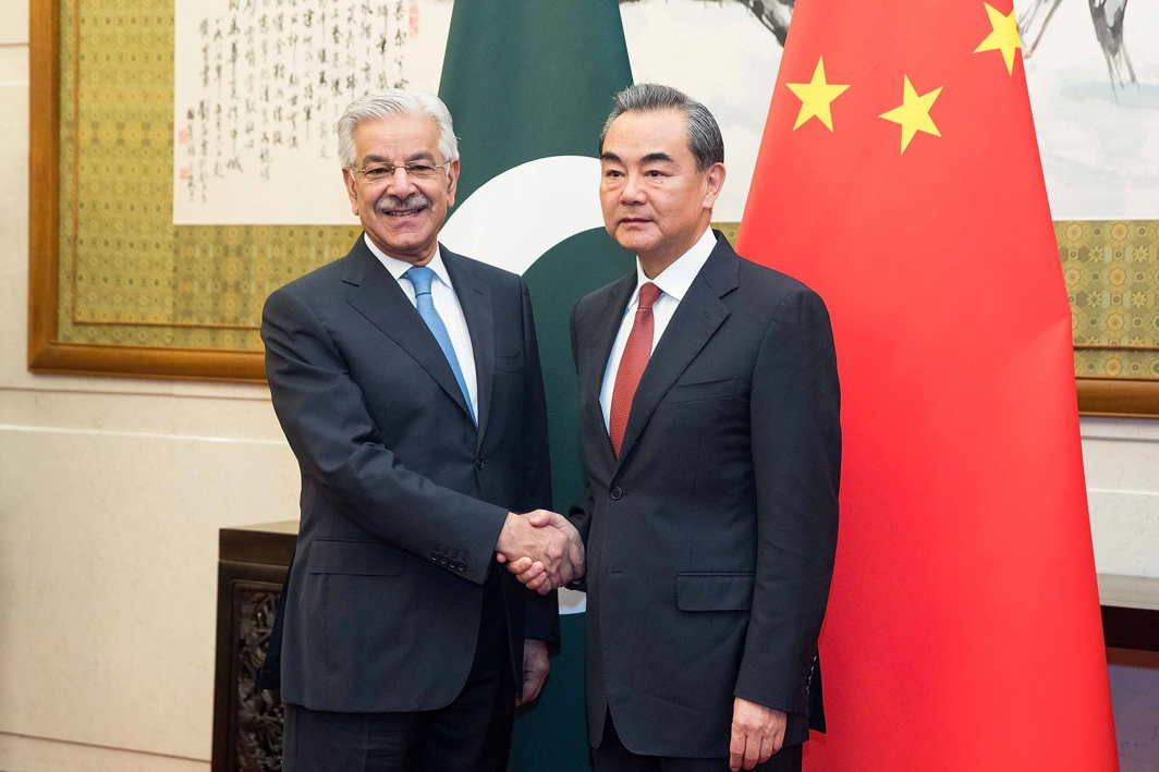 CHANGING MATRIX: Chinese Foreign Minister Wang Yi (R) shakes hands with Pakistan Foreign Minister Khawaja Muhammad Asif (L) at Diaoyutai State Guesthouse in Beijing, Reuters/UNI