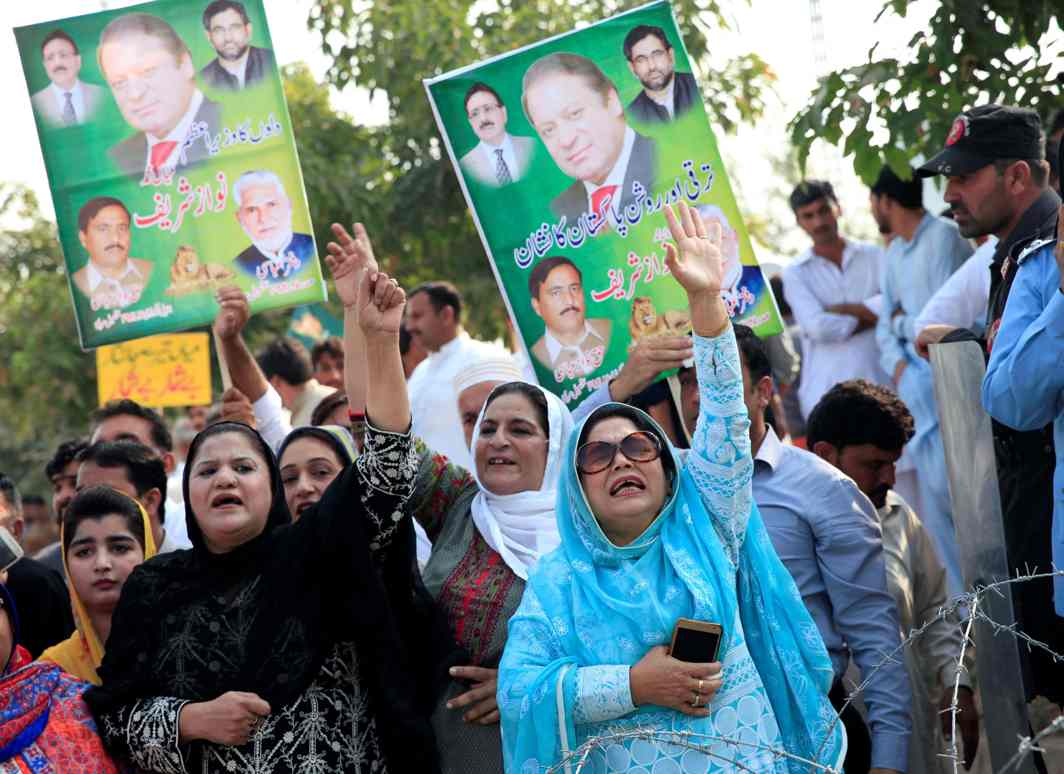 LOST CAUSE: Supporters of Pakistan's former Prime Minister Nawaz Sharif chant slogans during his appearance before the accountability court in connection with the corruption references filed against him, in Islamabad, Pakistan, Reuters/UNI