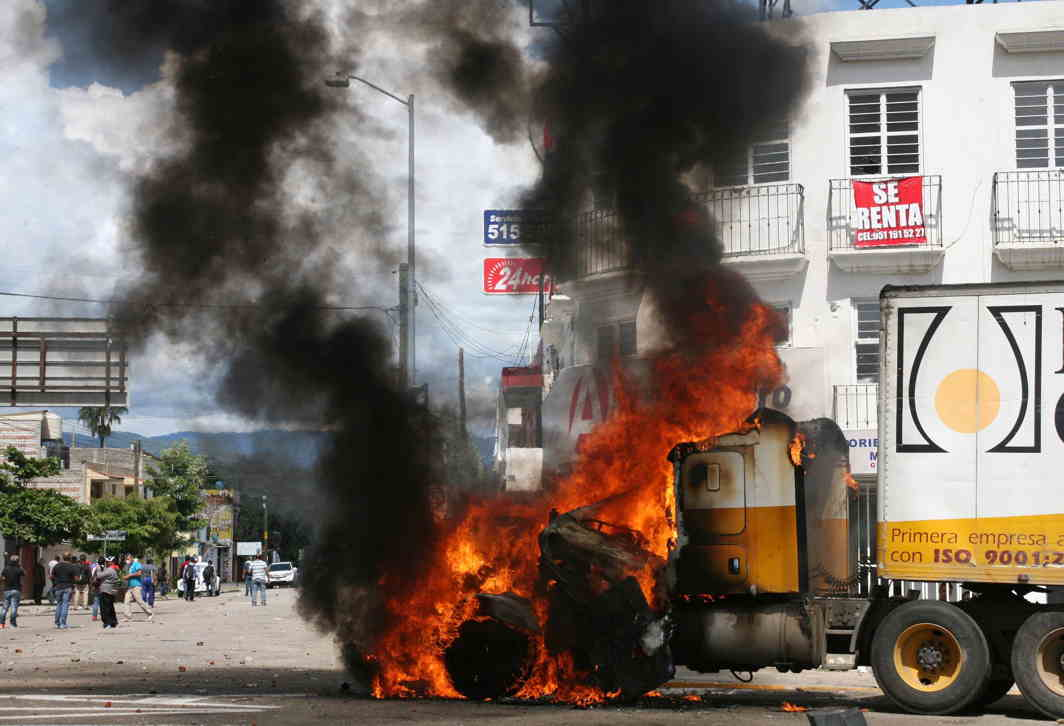 TROUBLE SPOT: A truck burns after it was set on fire during protests against Mexico's President Enrique Pena Nieto who arrived on an official visit, in Oaxaca, Reuters/UNI