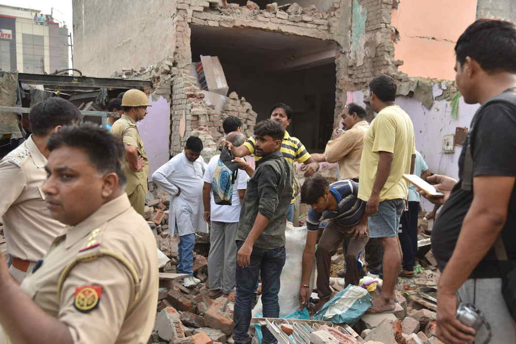 WHEN TRAGEDY STRIKES: Police and administration officials inspect rescue work at the site of an LPG cylinder blast in Bimanagar locality in Aligarh in which two died and dozens were injured, UNI