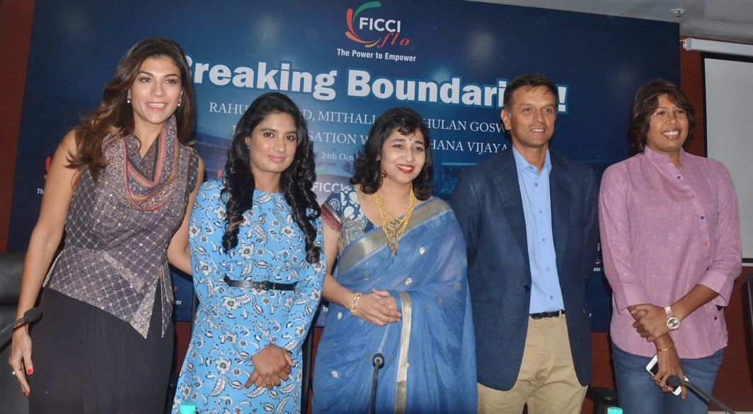 UNITED BY SKILL: Former Indian cricket captain Rahul Dravid (2nd R), Indian women's cricket team captain Mithali Raj (2nd L), cricketer Jhulan Goswami (L) and other delegates at a seminar on women empowerment in sports organised by FICCI Ladies Organisation in New Delhi, UNI