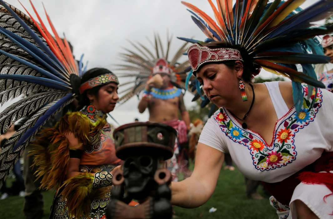 """WHO WE ARE: Revellers perform during a """"pow-wow"""" celebrating the Indigenous Peoples' Day Festival in Randalls Island, New York, US. The festival is held as a counter-celebration to Columbus Day and to promote Native American culture and history, Reuters/UNI"""