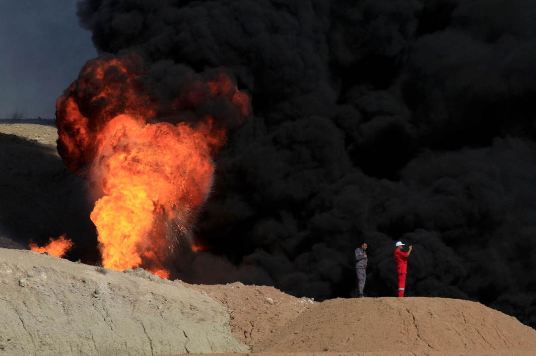 THE BURNING FIELDS: Smoke rises from oil wells, in Dibis area on the outskirts of Kirkuk, Iraq, Reuters/UNI