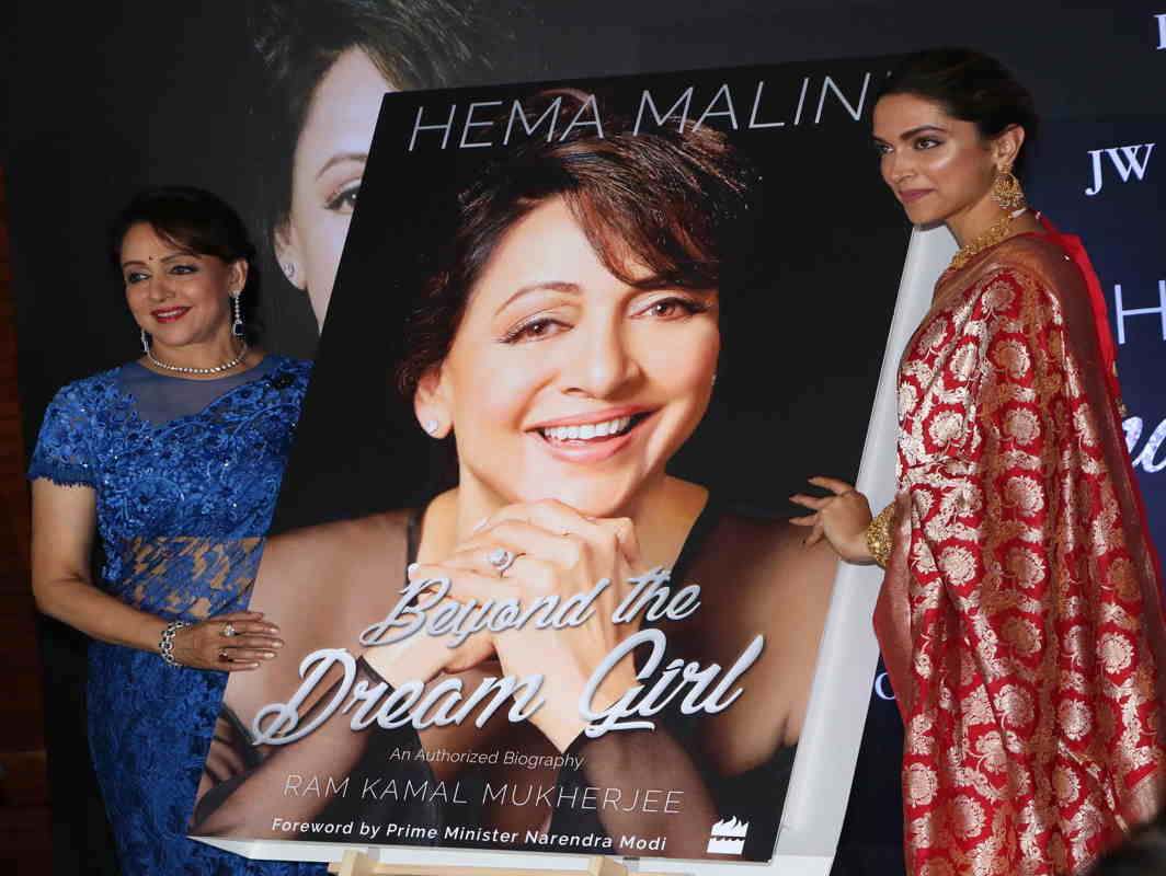 """AN ENIGMA: Bollywood actress Deepika Padukone, with Hema Malini, launches the official biography of the legendary actress Hema Malini """"Beyond the Dream Girl"""" in Mumbai, UNI"""
