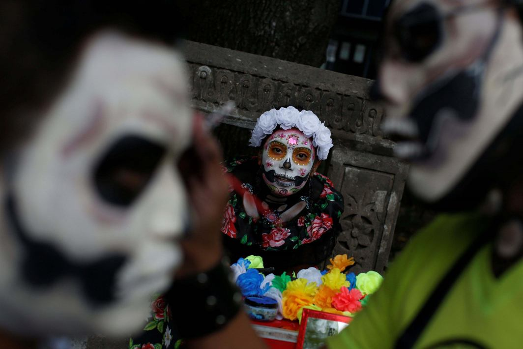 "SKELETON PARADE: A woman dressed up as ""Catrina"", a Mexican character also known as ""The Elegant Death"", takes part in a Catrina's parade in Mexico City, Reuters/UNI"