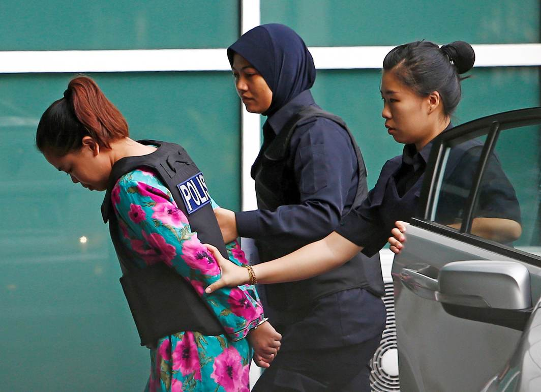 MURDERER OR HERO: Indonesian Siti Aisyah who is on trial for the killing of Kim Jong Nam, the estranged half-brother of North Korea's leader, is escorted as she arrives at the Department of Chemistry in Petaling Jaya, near Kuala Lumpur, Malaysia, Reuters/UNI