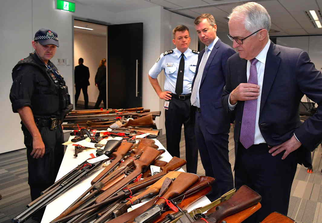 GUNS UNDER CONTROL: Australian Prime Minister Malcolm Turnbull with Australian Federal Police Commissioner (AFP) Andrew Colvin and Australian Justice Minister Michael Keenan at firearms on display in Sydney, Australia, Reuters/UNI
