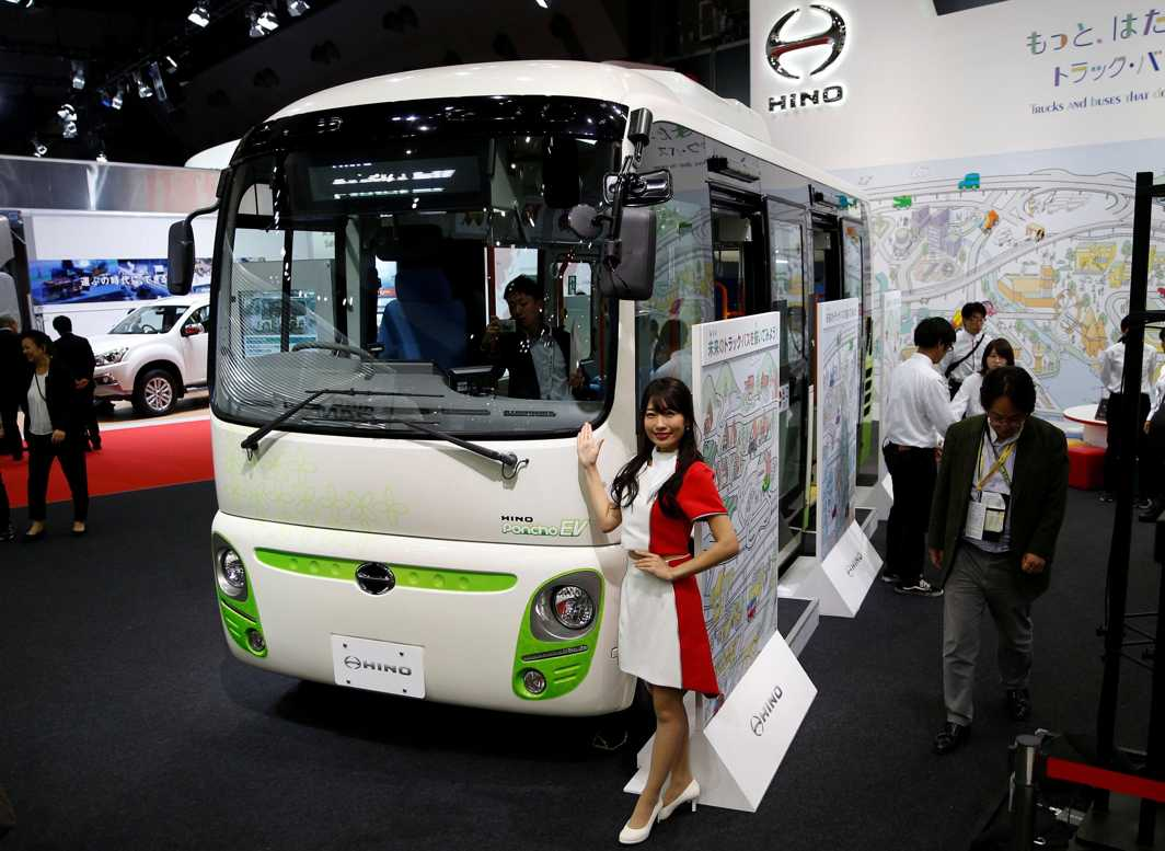 STYLISH AND FAST: A model presents Hino Motors' Poncho EV bus during the media preview of the 45th Tokyo Motor Show in Tokyo, Japan, Reuters/UNI
