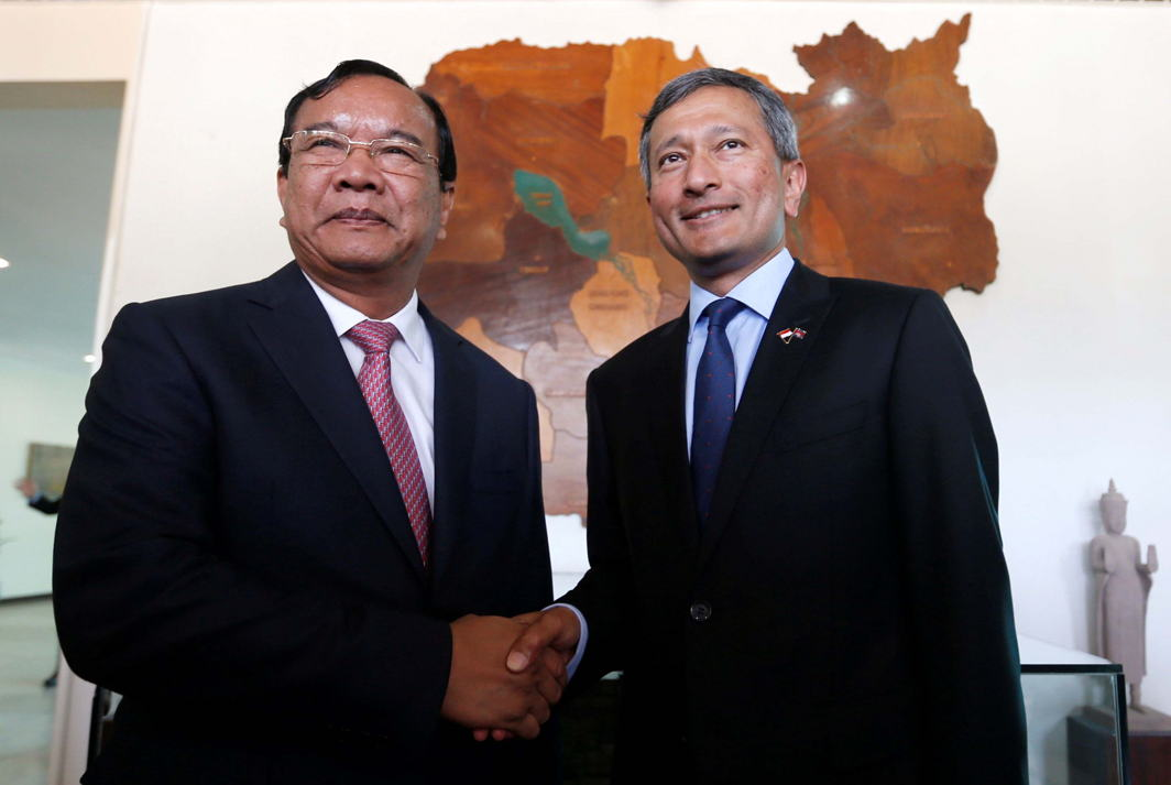 FOSTERING TIES: Singapore's Foreign Minister Vivian Balakrishnan (right) shakes hands with his Cambodian counterpart Prak Sokhon before a meeting at the Ministry of Foreign Affairs and International Cooperation in Phnom Penh, Cambodia, Reuters/UNI