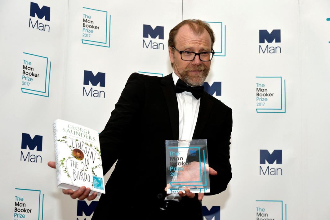 MASTER OF LETTERS: George Saunders, author of 'Lincoln in the Bardo', poses for photographers after winning the Man Booker Prize for Fiction 2017 in London, Reuters/UNI
