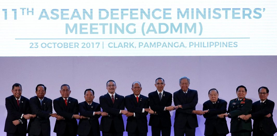 BEFORE THE PARLEYS: Participants pose for a family photo during the Asean defense ministers' meeting at Clark Field, Angeles City in Pampanga province, Philippines, Reuters/UNI