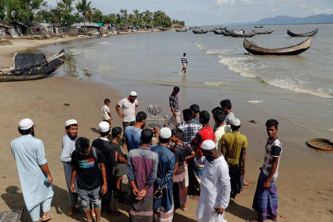 CRUELLY SNUFFED OUT: Local residents gather around bodies of Rohingya refugee children from Myanmar who were killed when their boat capsized on the way to Bangladesh, in Shah Porir Dwip, in Teknaf, near Cox's Bazar in Bangladesh, Reuters/UNI