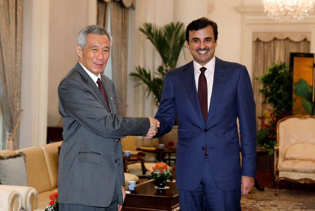 HERE WE ARE: Qatar's Emir Sheikh Tamim bin Hamad al-Thani meets with Singapore's Prime Minister Lee Hsien Loong at the Istana in Singapore, Reuters/UNI