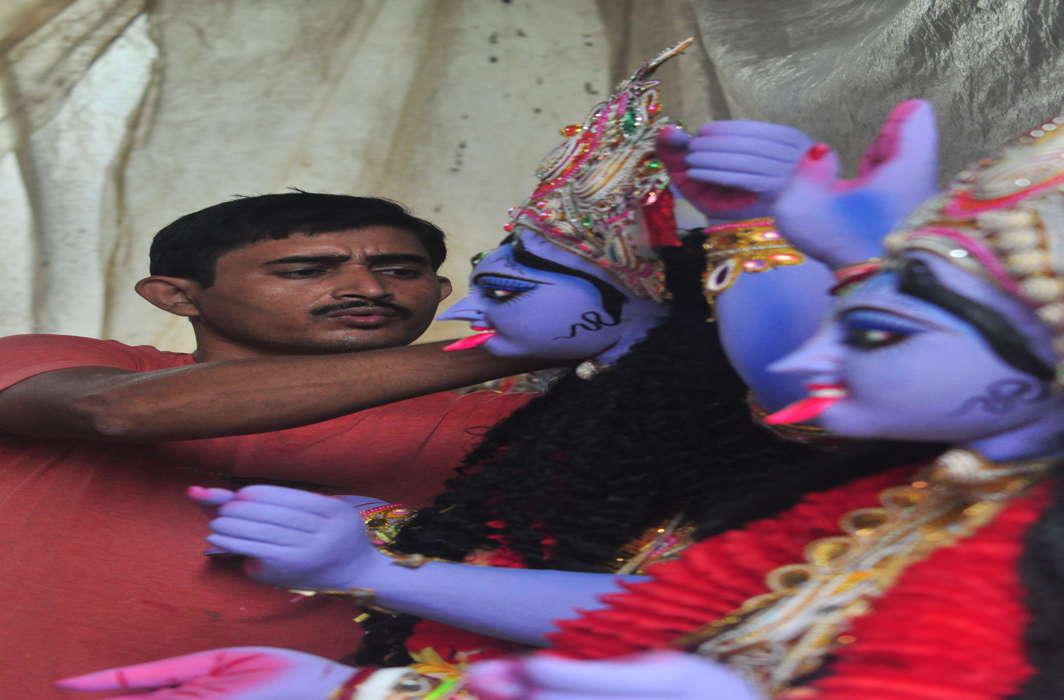BLUE GODDESS: Artisans give finishing touches to idols of Goddess Kali on the eve of Kali Puja festival in Agartala, UNI