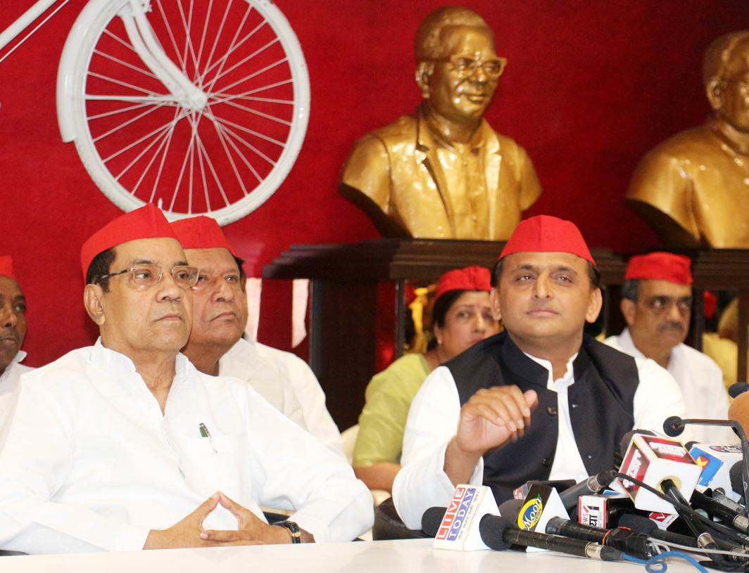 RED CAPS: Samajwadi Party president Akhilesh Yadav addresses a press conference in Lucknow, UNI