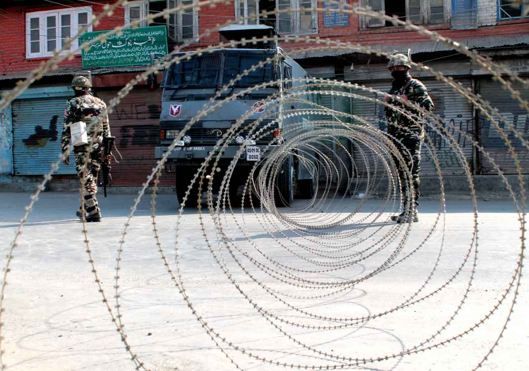 DON'T GO THERE: Concertina wire laid at Hawal Chowk in downtown Srinagar where curfew-like restrictions are imposed to prevent violence following strike called by separatists against braid chopping incidents in the Kashmir valley, UNI