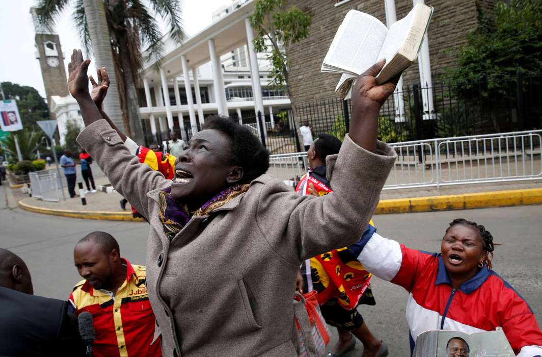 EXULT, O FOLKS: Jubilee Party supporters cheer after Kenya's Supreme Court upholds the re-election of President Uhuru Kenyatta in last month's repeat presidential vote, in Nairobi, Reuters/UNI