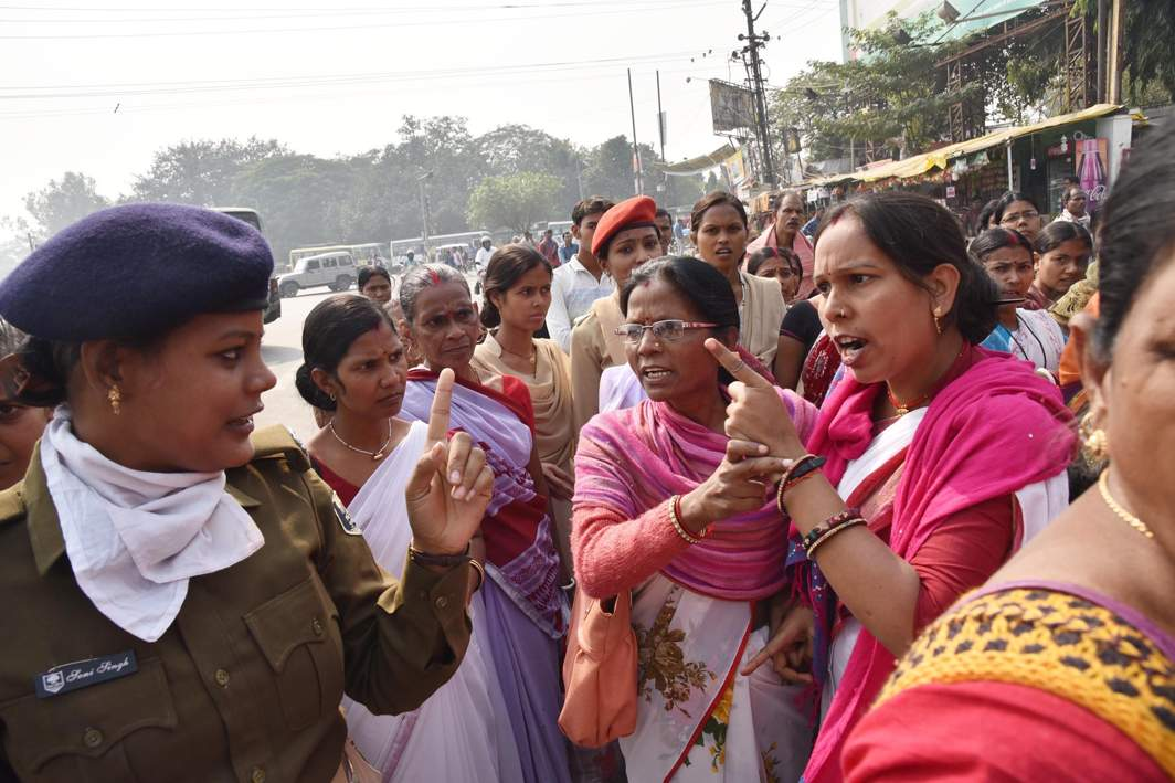 AT THE RECEIVING END: Anganwadi volunteers argue with police during their demonstration in support of their demands of equal pay for equal work, in Patna, UNI