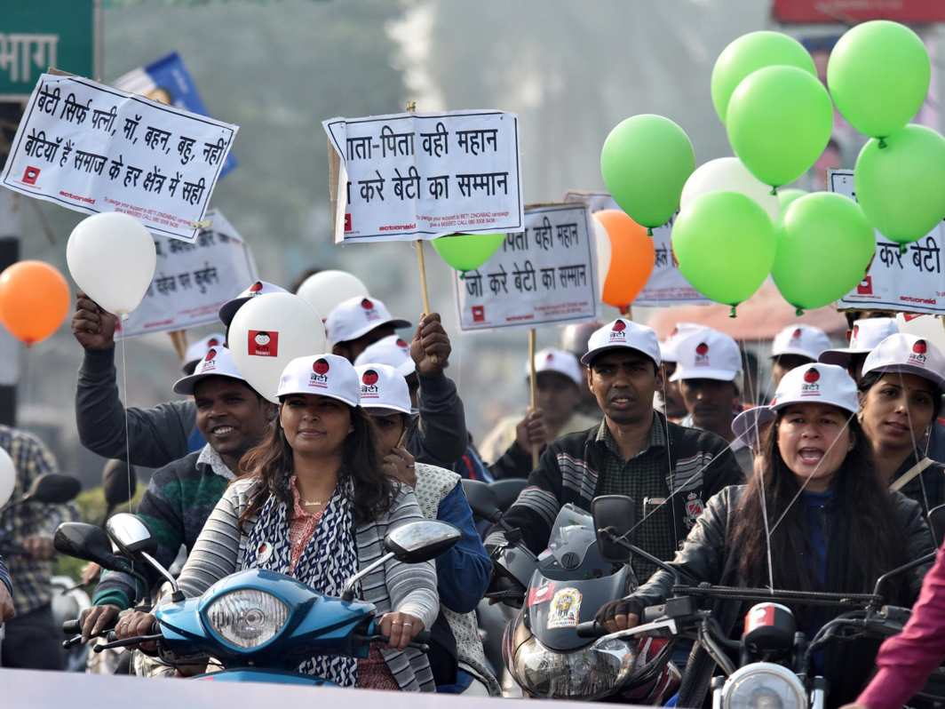 GIRLS, TOO, CAN BE SAFE : Women on scooties participate in an awareness campaign on violence against women and Beti Bachao in Patna, UNI