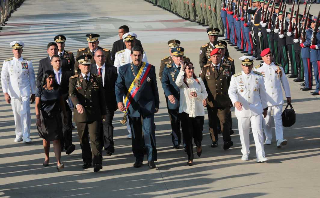 EYES TO THE FRONT: Venezuela's president Nicolas Maduro (C) arrives for a military parade, next to his wife Cilia Flores (front row, centre R), Venezuela's Defence Minister Vladimir Padrino Lopez (front row, centre L) and president of the National Constituent Assembly Delcy Rodriguez (front row, L), in Maracay, Venezuela, Miraflores Palace/Reuters/UNI