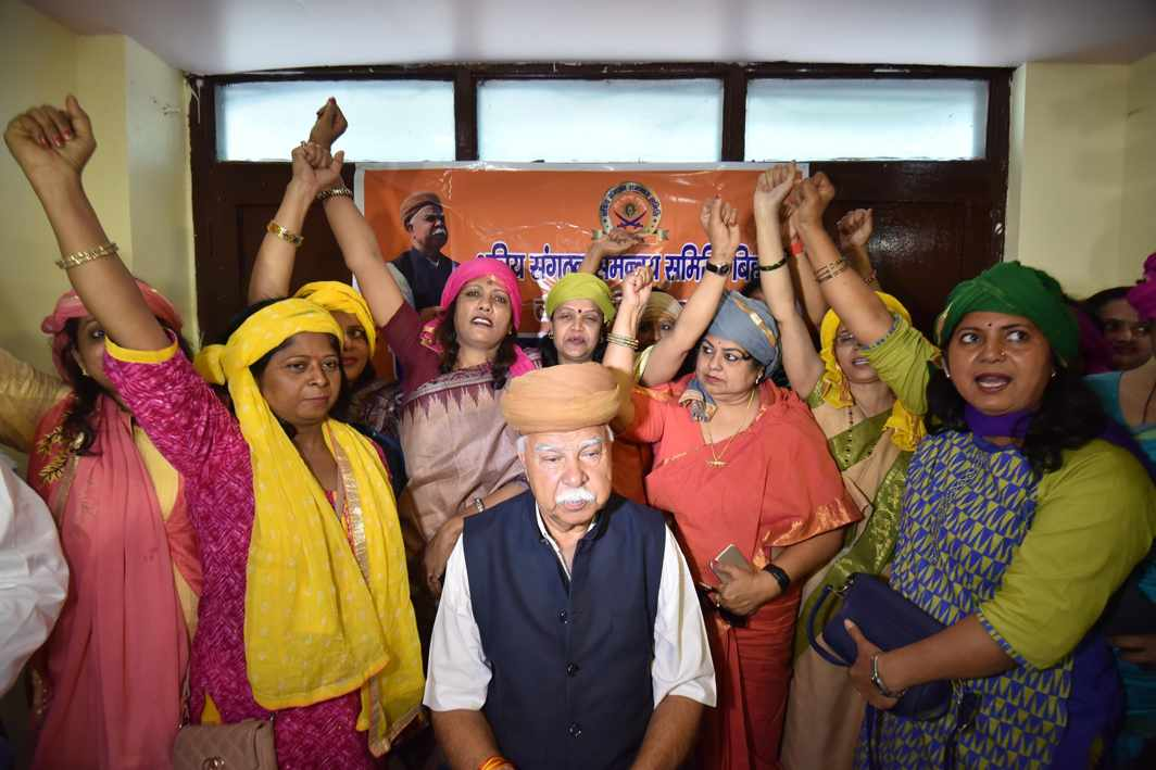 """HUBRIS NOT HONOUR: Rajput Karni Sena president Lokendra Singh Kalvi, along with women from the Rajput community, shout slogans during a press conference organised to demand ban on the release of upcoming film """"Padmavati"""" in Patna, UNI"""